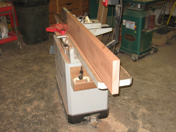 Rough sawn boards being straightened on the jointer.