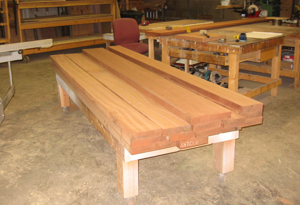 Stack of hardwood for a solid wood dining table.